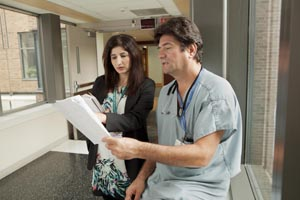 two health care professional working together