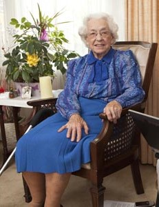 elderly woman sitting in a chair