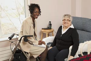 Care coordinator sitting with elderly woman