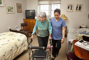 Lady with a walker and Personal Support Worker