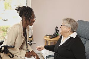 A health care provider and a client share a laugh