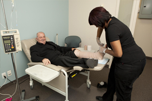 Health care provider changes client's foot bandage
