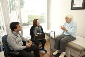 A patient speaks with health care providers