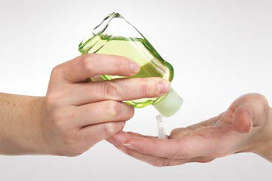 hands using hand sanitizer