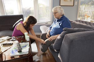 Healthcare provider examining a patient's leg