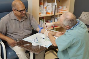 Man getting blood drawn at clinic