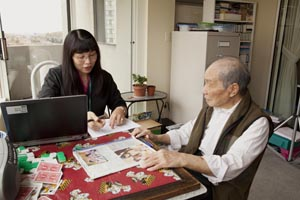 A patient reviewing long-term care home information with a care provider