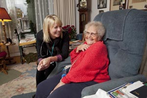 a patient at home with her care coordinator