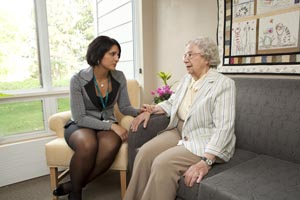 a care coordinator listens to a long term care home resident