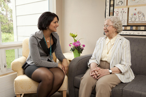 a care coordinator discusses care at home with an elderly woman