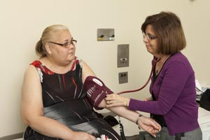 health care worker taking patient's blood pressure