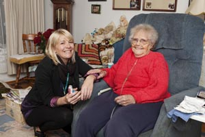 smilling caregiver and elderly woman
